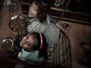 Girls eating dal bhat in their parent's shop in Kathmandu